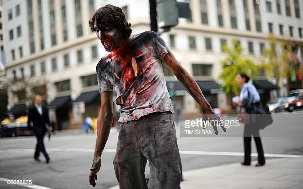 An actor portraying a zombie catches people off guard to promote the new TV series The Walking Dead on the AMC channel on October 26 2010 outside the...
