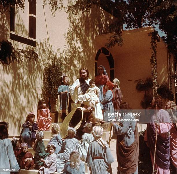 An actor portraying Jesus Christ addresses a crowd consisting of most children women and men all also actors as part of the Black Hills Passion Play...