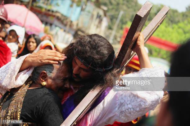 An actor portraying Jesus Christ hugs a woman while performing a reenactment from the Stations of the Cross in Mumbai India on 14 April 2019 The 14...