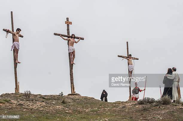 An actor portraying Jesus is crucified as residents of Hiendelaencia dressed in period clothing perform during the reenactment of Christ's suffering...
