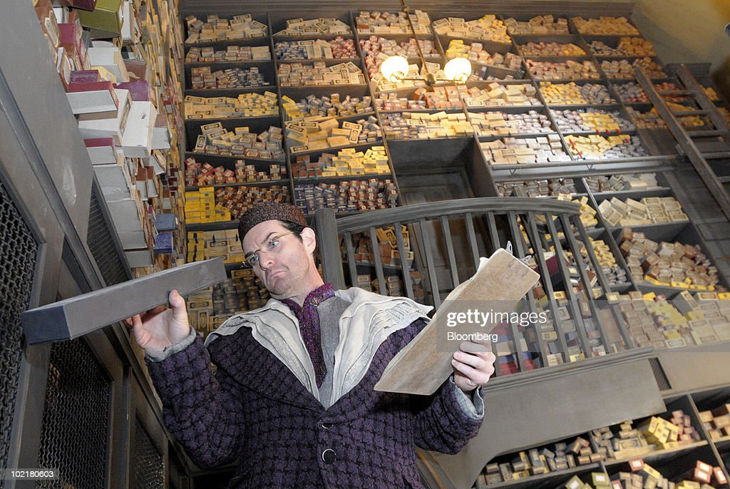 An actor portraying the wandkeeper looks through his collection of wands inside Ollivanders at the Universal Studios Wizarding World of Harry Potter theme park in Orlando, Florida, U.S., on Thursday, June 17, 2010. Universal reportedly spent $265 million building the theme park, based on a Securities & Exchange Commission filing. Photographer: Phelan M. Ebenhack/Bloomberg via Getty Images