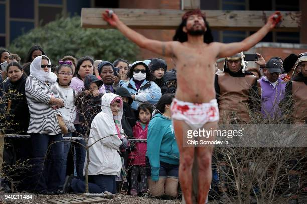An actor portrays Jesus Christ crucified during a traditional Via Crucis or Way of the Cross procession on the Christian Good Friday holiday March 30...