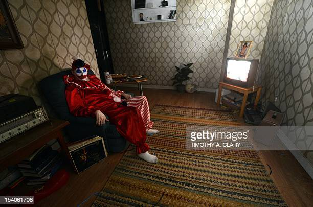An actor portrays serial killer John Wayne Gacy at Killers A Nightmare Haunted House at Clemente Soto Vélez Cultural Center on October 5 2012...
