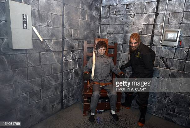 An actor portrays Ted Bundy on the electric chair at Killers: A Nightmare Haunted House, at Clemente Soto Vélez Cultural Center on October 5, 2012....