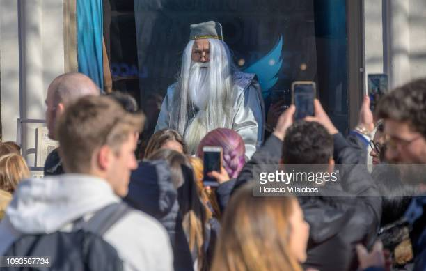 An actor posing as an of Harry Potter characters reads novels' texts sitting at the shopwindow in Lello Bookstore to during its 113th anniversary on...