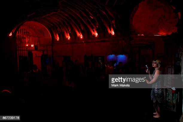 An actor sings at a speakeasy portion of 'Terror Behind the Walls' haunted house on October 24 2017 in Philadelphia Pennsylvania The haunted house...