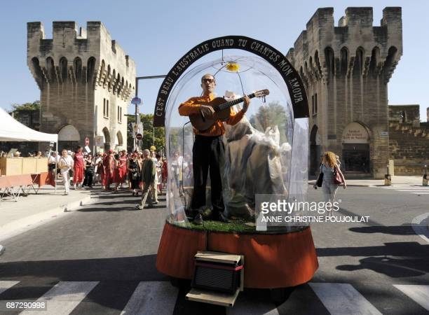 An actor stands on a float on July 9 in Avignon southeastern France during the opening parade of Avignon international theater Off festival AFP PHOTO...