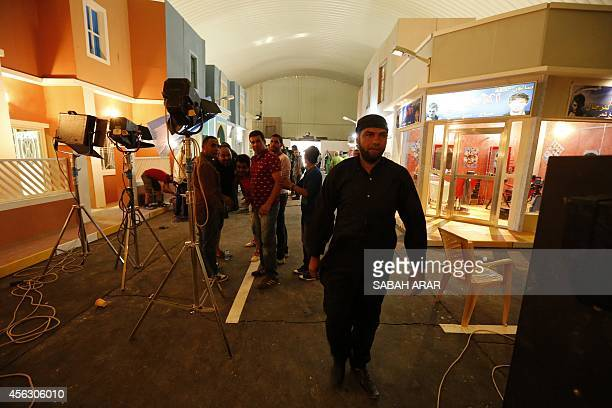 An actor walks on the set of the television series whose title is loosely translated as 'State of Superstition' during filming in the Iraqi capital...