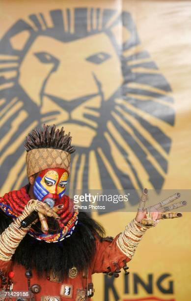 An actor who performs in 'The Lion King' attends a promotion event at the Shanghai New World shopping mall July 12 2006 in Shanghai China The musical...