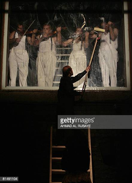 An actor wipes soap suds off a widow allowing the audience to watch four men playing classical music, the genre of music allegedly used in torcher...