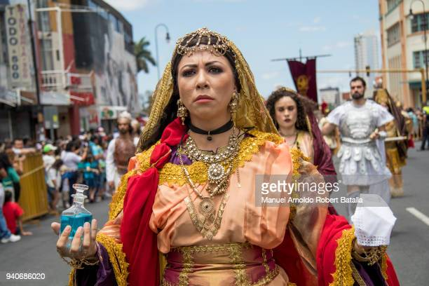 An actress dressed as Mary Magdalen performs during the Holy Friday Procession as part of the Holy Week Celebration in Costa Rica on March 29, 2018...