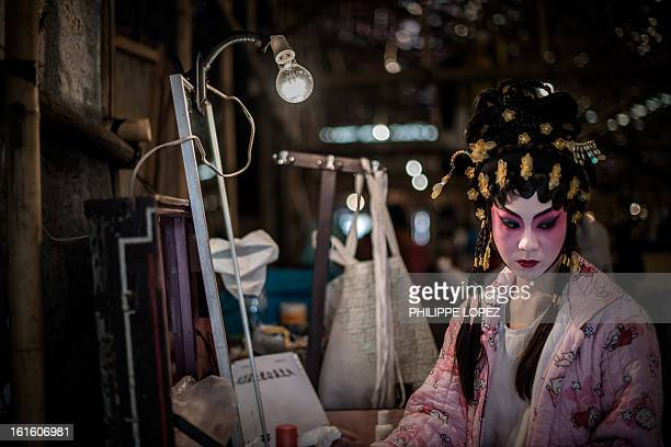 An actress looks on in the backstage of the Bamboo Theatre a 800seat temporary theater made of bamboo to house a special serie of Cantonese opera...