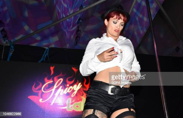 An actress performs a striptease during the celebration of the Erotic Salon of Barcelona
