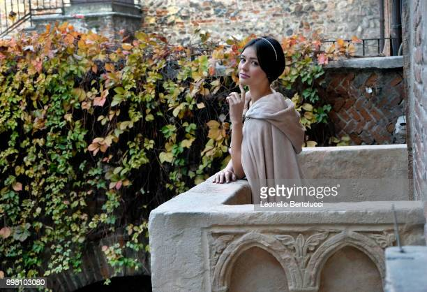 """An actress representing Juliet stands on 'Juliet's Balcony' in Via Cappello 23 which is today known as """"Juliet's House"""" on November 20 2017 in Verona..."""