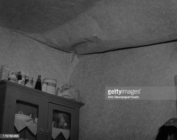 An acute housing situation has arisen since new government low-rent homes are being built, Chester, Pennsylvania, 1950. The ceiling of the kitchen,...