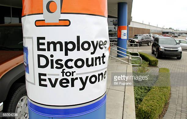 An ad at a General Motors Chevrolet dealership announces GM's new incentive program which allows all buyers to be eligible for the company's GM...