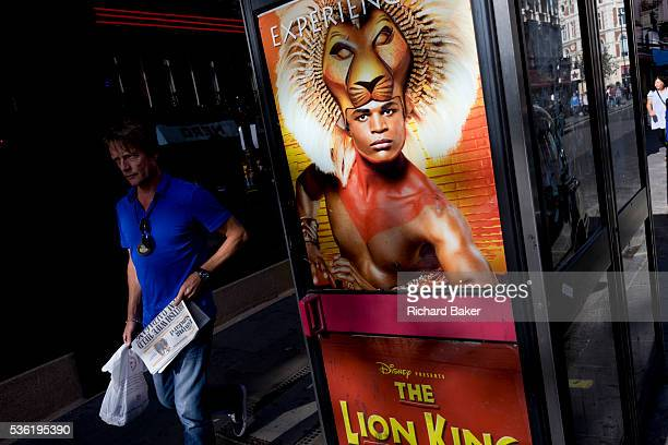 An ad poster with the actor Andile Gumbi as Simba in the Lion King is on the door of a central London telephone kiosk for the Disney production The...