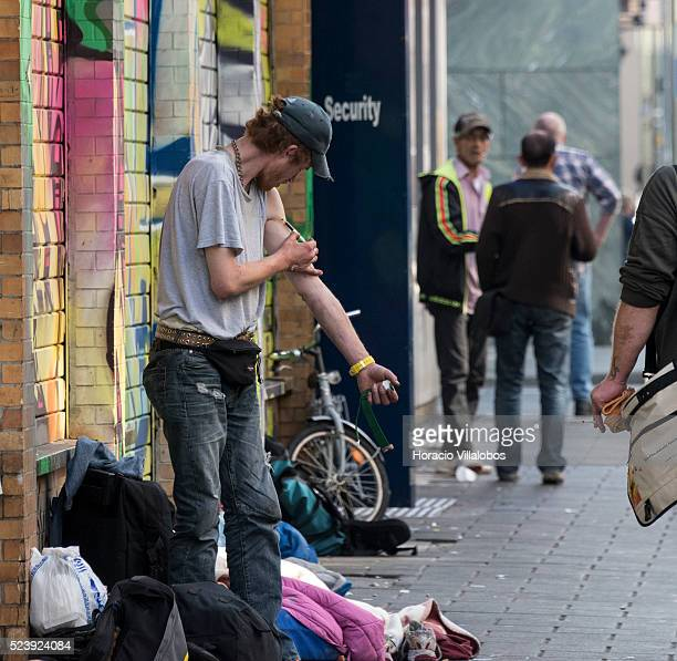 An addict injects himself outside a methadone dispenser in the Redlight district Frankfurt Germany 29 September 2014 The Redlight district area in...