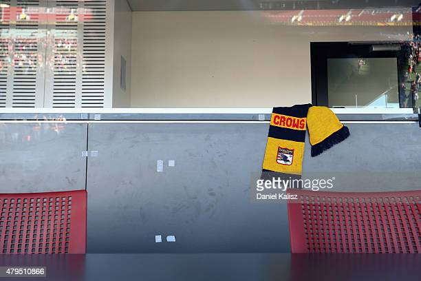 An Adelaide Crows scarf is pictured in the Crows coaches box at the seat of the late Phil Walsh at Adelaide Oval on July 5 2015 in Adelaide Australia...