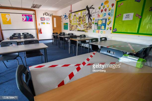 An adhesive tape cross sits on a restricted classroom desk at All Saints Catholic College ahead of reopening for students in Manchester, U.K., on...