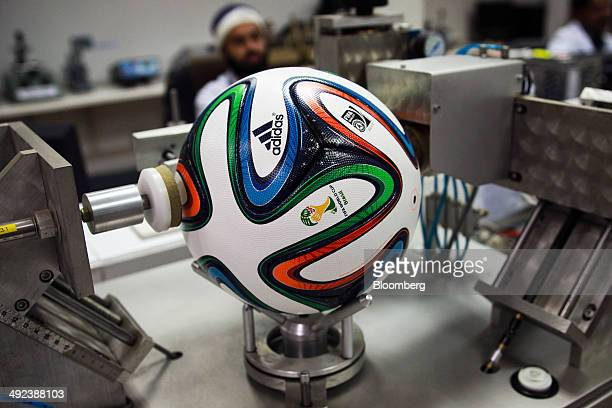 An Adidas AG 'Brazuca' soccer ball undergoes a circumference and sphericity check at the Forward Sports Ltd factory in Sialkot Punjab Pakistan on...