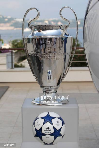 An Adidas ball on show alongside the Champions League trophy during the UEFA Champions League Group Stage draw at the Grimaldi Forum on August 26...