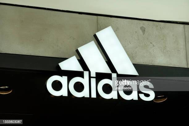 An Adidas sign at the entrance to the store on August 12, 2021 in Miami, Florida. Adidas is reported to have reached an agreement to sell its Reebok...