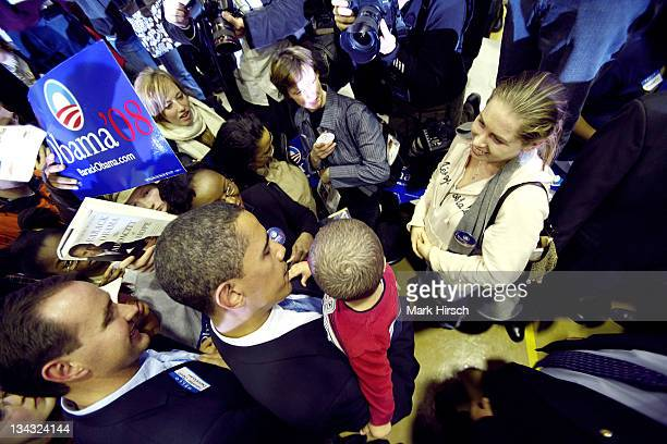An admiring mother looks on as Illinois Senator Barack Obama holds her son as he makes his way through the crowd following a campaign stop at the...