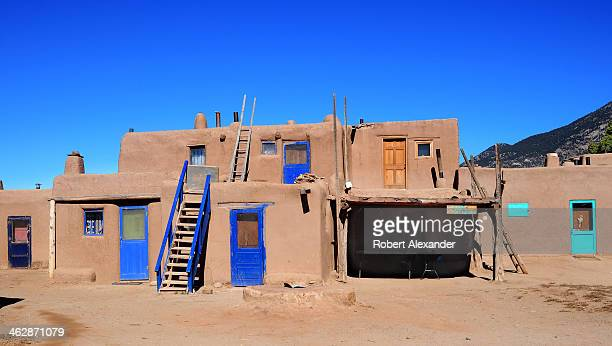 An adobe home in Taos Pueblo an ancient Native American community near the modern city of Taos New Mexico The adobe homes in the pueblo were built...