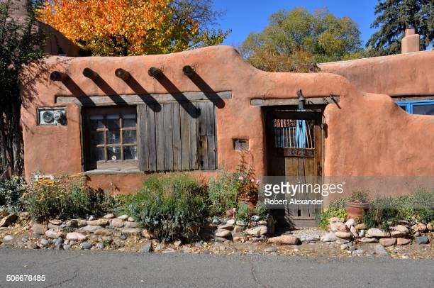 An adobe house along Santa Fe New Mexico's historic Canyon Road home of dozens of art galleries