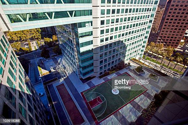 An Adobe logo is displayed on an outdoor basketball court at the company's headquarters building in San Jose California US on Tuesday Sept 7 2010...