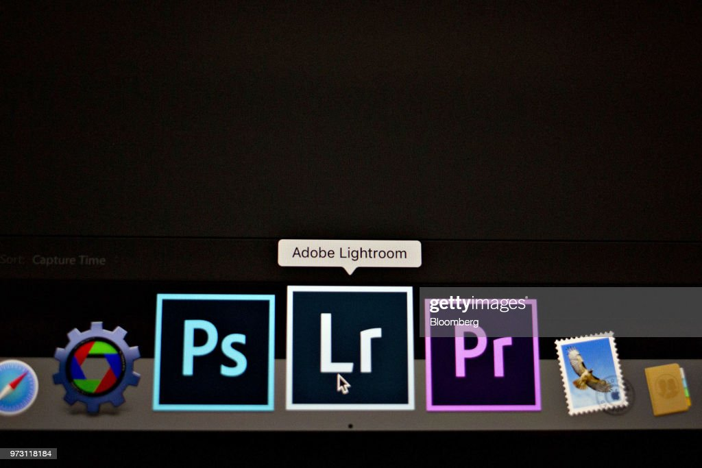 An Adobe Systems Inc. Lightroom application shortcut is displayed between Photoshop, left, and Premiere Pro icons on a computer monitor in Tiskilwa, Illinois, U.S., on Friday, June 8, 2018. Adobe Systems Inc. is scheduled to release earnings figures on June 14. Photographer: Daniel Acker/Bloomberg via Getty Images