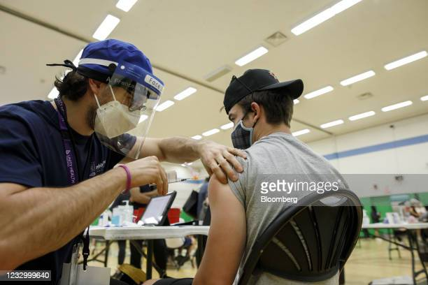 An adolescent receives a dose of the Pfizer-BioNTech Covid-19 vaccine at a clinic in Toronto, Ontario, Canada, on Wednesday, May 19, 2021. Canada is...