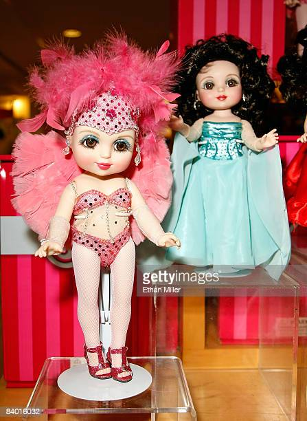 An Adora Pink Flamingo Belle doll and an Adora Good Morning Belle doll by Marie Osmond are displayed during Osmond's doll signing event at the...