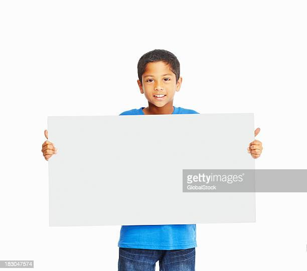 An adorable boy holding banner isolated on white background