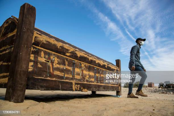 An adorned wooden sarcophagus is displayed during the official announcement of the discovery by an Egyptian archaeological mission of a new trove of...