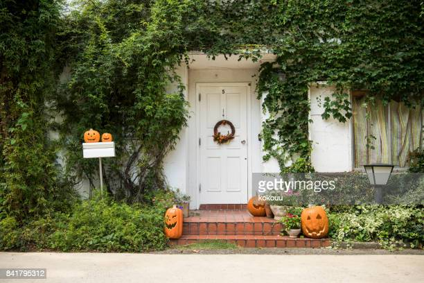 an adornment decorated on the day of halloween. - scary pumpkin faces stock photos and pictures