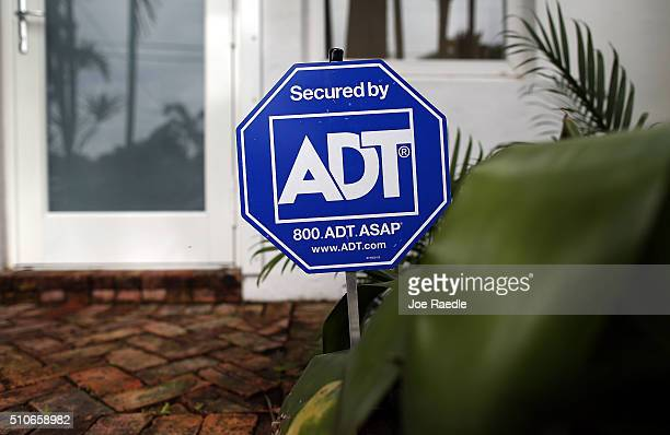 An ADT home security alarm sign is seen in front of a home on February 16 2016 in Miami Florida It was announced today that home security firm ADT...