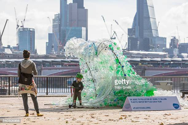 An adult and child take a look at The Wave sculpture by Wren Miller commissioned to launch BRITA's sustainability campaign on display on June 15,...