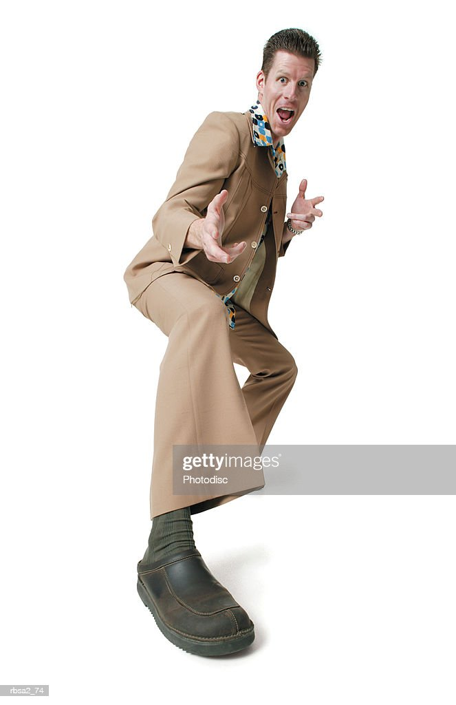 an adult caucasian man dressed in a disco leisure suit as he strikes a fun pose and smiles : Foto de stock