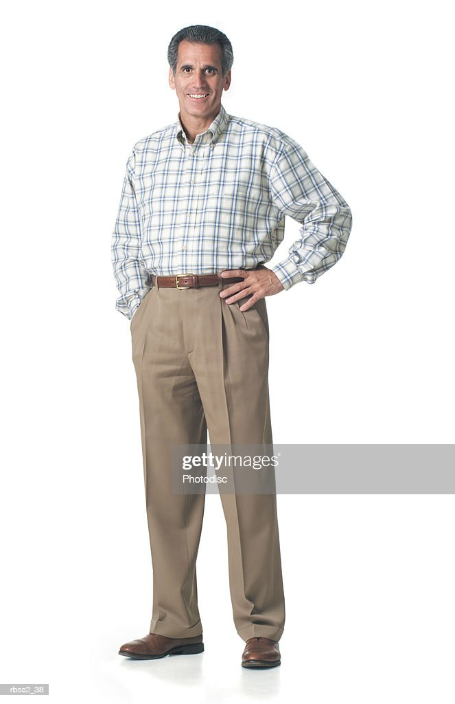 an adult caucasian man in tan pants and a plaid shirt smiles into the camera : Foto de stock