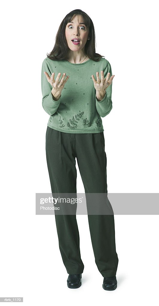an adult caucasian woman in a green sweater gestures with her hands as she appears shocked : Stockfoto