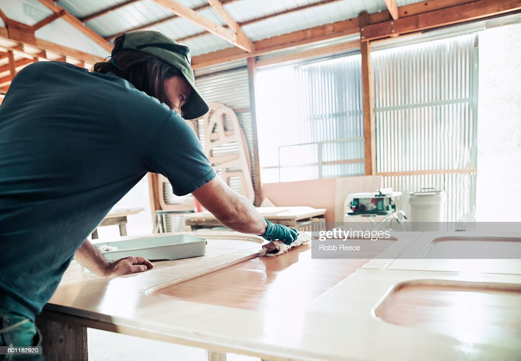 An adult, male carpenter working in his wood shop : Stock Photo