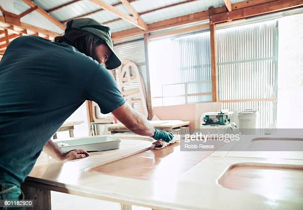 an adult, male carpenter working in his wood shop - robb reece stock pictures, royalty-free photos & images