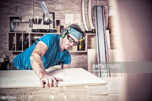 an adult, male carpenter working with tools in his wood shop - robb reece stock pictures, royalty-free photos & images