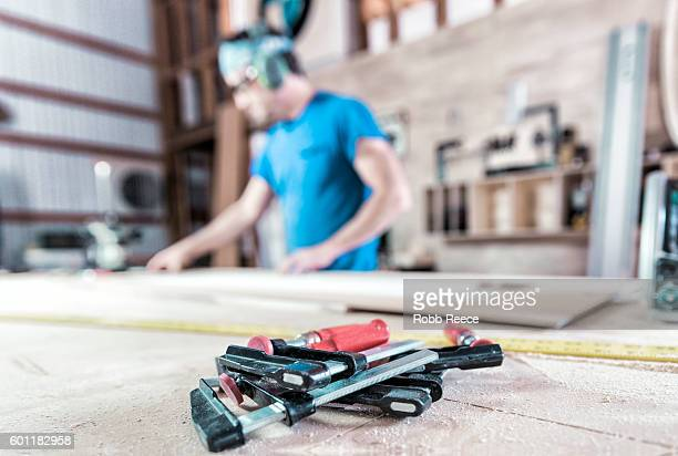 an adult, male carpenter working with tools in his wood shop - robb reece stock-fotos und bilder