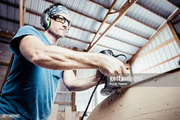 an adult, male carpenter working with tools in his wood shop - robb reece fotografías e imágenes de stock