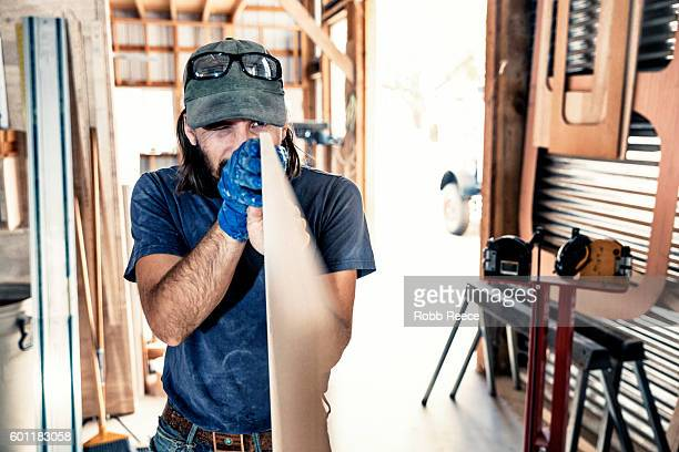 an adult, male carpenter working with wood in his wood shop - robb reece stock pictures, royalty-free photos & images