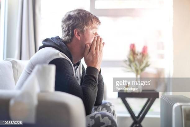 an adult male sick at home. - blame stock pictures, royalty-free photos & images