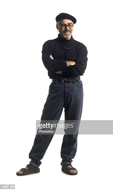 an adult man dressed in black folds his arms and smiles - beatnik stock pictures, royalty-free photos & images